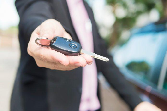 man giving key